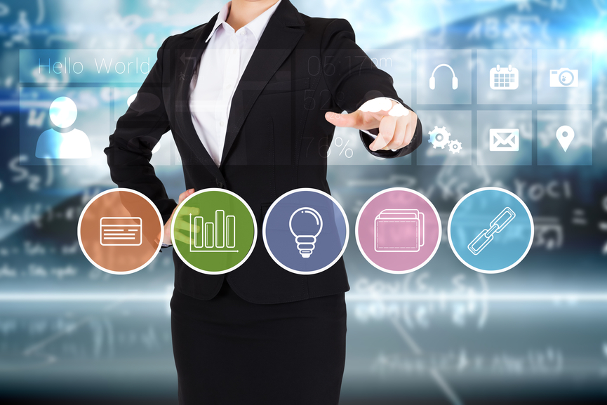 Businesswoman in suit pointing finger to business app buttons on blue background